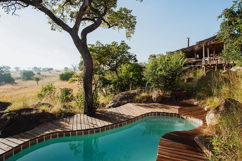 serengeti safari camps Great Wildebeest Migration namad lamai camp main pool area view of savannah
