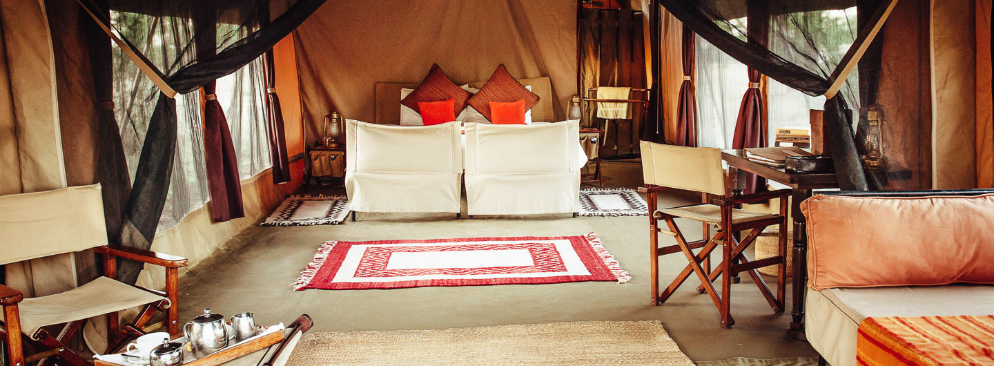 serengeti safari camps Great Wildebeest Migration olakira camp interior tented suite private lounge wooden furniture