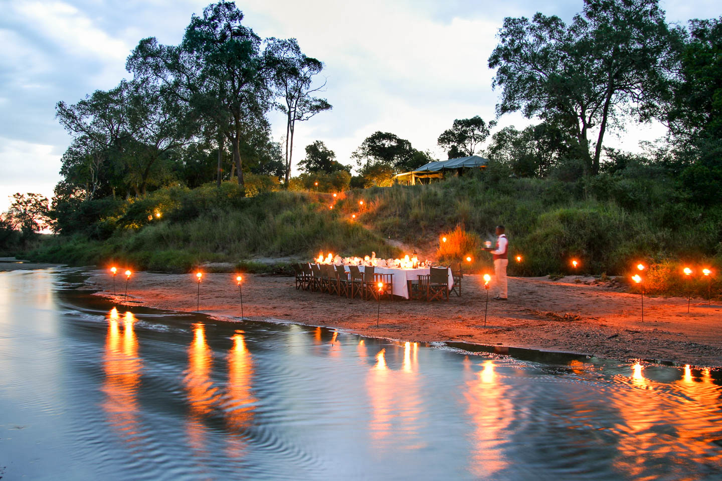 serengeti safari camps Great Wildebeest Migration salas camp sand river dinner candle lights
