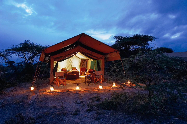 serengeti safari camps Great Wildebeest Migration ubuntu camp exterior tented suite twilight lanterns